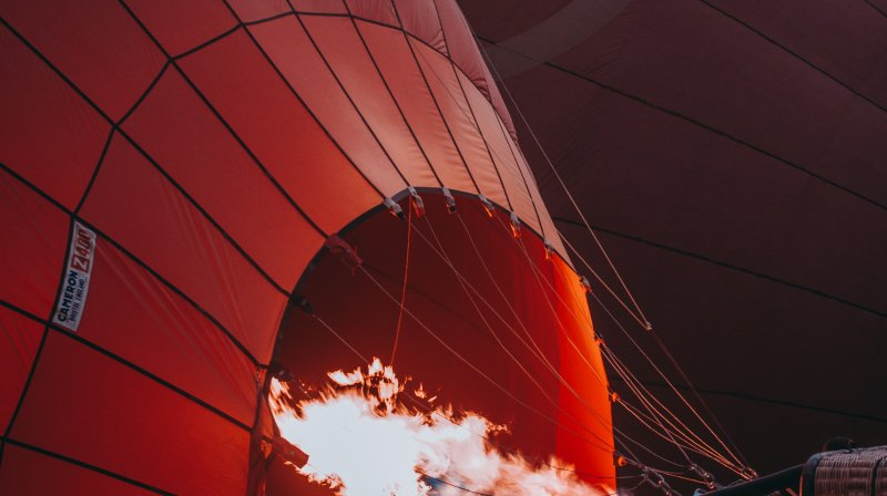 A hot air balloon being prepared for liftoff.