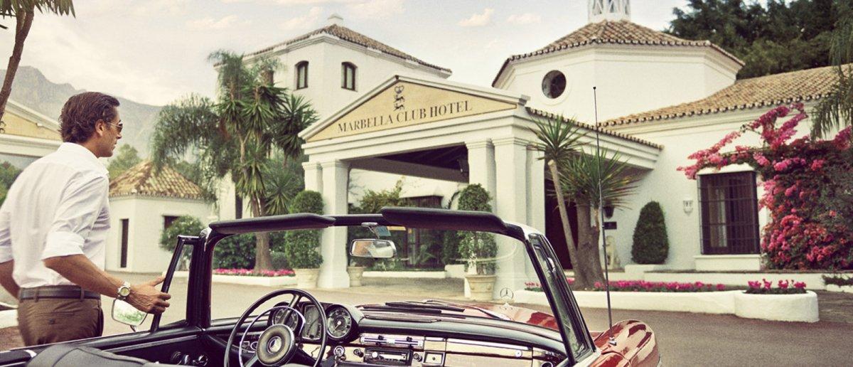 A vintage cabrio by the entrance to Marbella Club Hotel