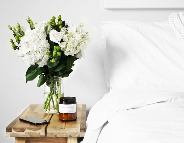 a hotel bed and flowers